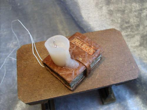 Spell Book with lit melting candle