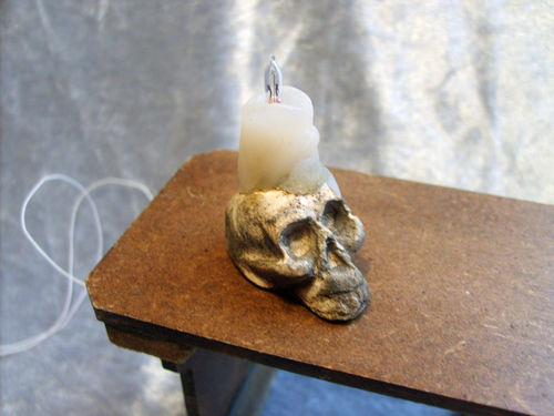 Skull with lit Melted Candle
