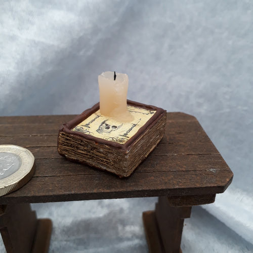 Book with Melting Candle 2