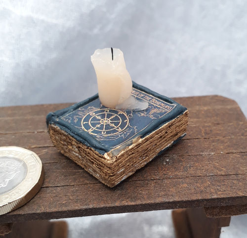 Book with Melting Candle 5